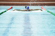 Swimmer racing in pool - CAIF14156