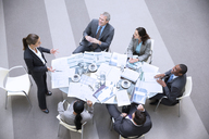 High angle view of gesturing businesswoman leading meeting - CAIF14234