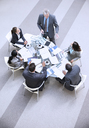 High angle view of businessman leading meeting - CAIF14240