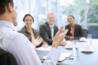 Businessman gesturing in meeting - CAIF14249