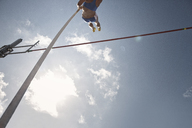 Pole vaulter clearing bar - CAIF14255
