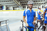 Portrait of track cyclist in velodrome - CAIF14258