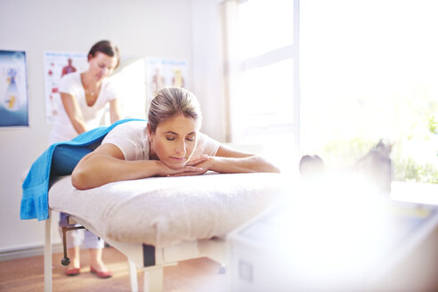 Woman receiving massage by physical therapist - CAIF14300
