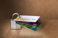 Credit cards attached to padlock - CAIF14474