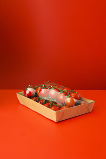 Close up of tomatoes shrink wrapped in plastic - CAIF14489