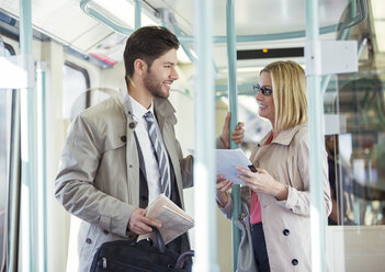 Business people talking on train - CAIF14570