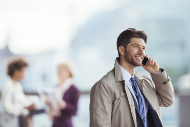 Businessman talking on cell phone outdoors - CAIF14588