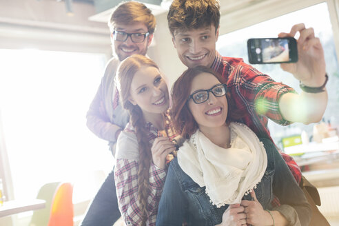 Friends taking selfie with camera phone - CAIF14621