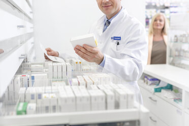 Pharmacist filling prescription in pharmacy - CAIF14681