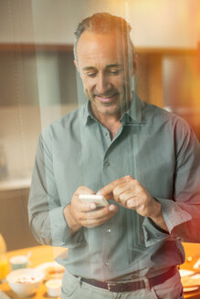 Older man texting on cell phone - CAIF14852