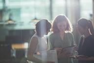 Businesswomen talking in office - CAIF14861