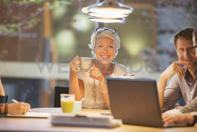 Businesswoman smiling in office meeting - CAIF14879 - Tom Merton/Westend61