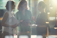Businesswomen talking in office - CAIF14897