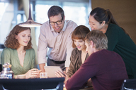 Business people using digital tablet in office meeting - CAIF14906