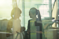 Businesswomen talking in office - CAIF14954
