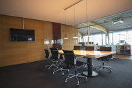 Conference table in empty office meeting room - CAIF14972