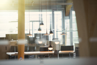 Light fixtures and desks in empty office - CAIF14978