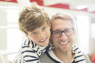 Father and son smiling - CAIF15005
