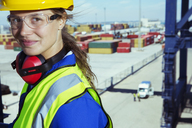 Worker smiling near cargo containers - CAIF15083