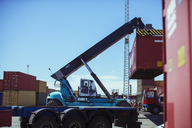 Crane lifting cargo container - CAIF15086