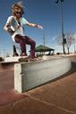 Man performing stunt at skateboard park - CAVF06243