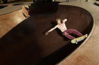 High angle view of shirtless man skateboarding on sports ramp - CAVF06264