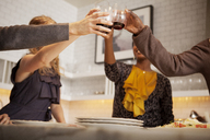 Low angle view of friends toasting wineglasses - CAVF06375