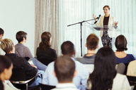 Businesswoman giving presentation in conference room - CAIF15246