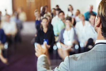 Businessman speaking to audience in conference room - CAIF15255
