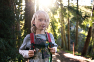 Portrait of boy with backpack standing in forest - CAVF06777