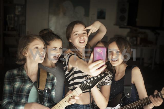 Happy friends taking selfie in recording studio - CAVF06936