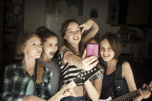 Happy friends taking selfie in recording studio - CAVF06936