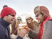 Friends celebrating with drinks in the snow - CAIF15291