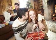 Couple exchanging gifts on Christmas - CAIF15399