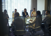 Business people attending meeting in conference room - CAIF15426