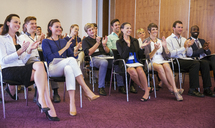 Business people watching presentation in conference room, clapping hands and smiling - CAIF15441