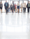 Large group of business people walking in office - CAIF15456