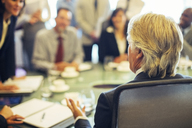 Rear view of mature businessman during business meeting - CAIF15459