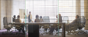 Business people watching presentation in conference room - CAIF15468