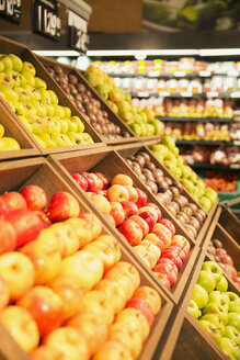 Close up of fruit in produce section of grocery store - CAIF15573