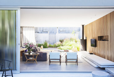 Sliding glass door opening to modern living room - CAIF15630