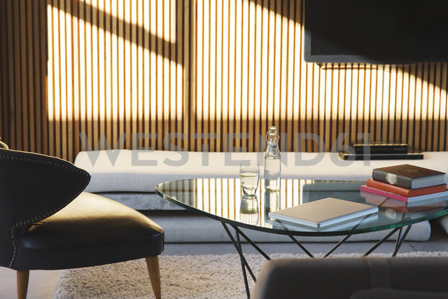Window casting shadows in modern living room - CAIF15633