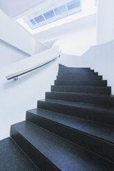 Black and white winding staircase of office building curving - CAIF15816