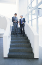 Businessmen talking on stairs - CAIF15825