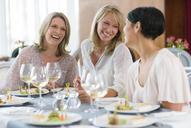 Women enjoying meal in restaurant - CAIF15840