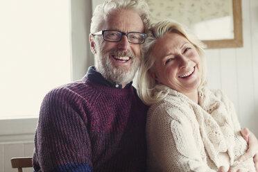 Portrait laughing senior couple hugging - CAIF15906