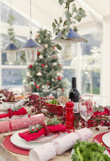 Placesetting and Christmas decorations on dining table - CAIF15978