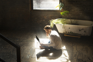 High angle view of man using laptop computer at home - CAVF07921