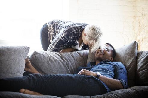 Happy multi-ethnic couple at home - CAVF08284
