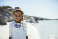 Young girl smiling on beach - CAIF16272